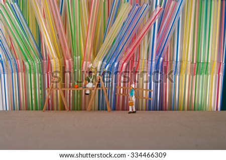 Little people paint the wall with straws. concept of teamwork. - stock photo