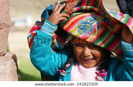 little peruvian playing - stock photo