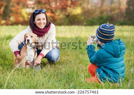 Little photographer - happy family moment - stock photo