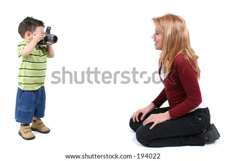 Little photographer photographing a beautiful teen girl. - stock photo