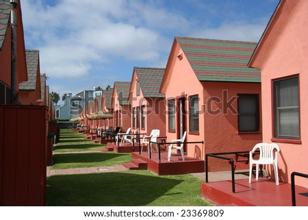Little pink beach houses in a row - stock photo