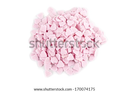 Little pink sugar hearts isolated on white background
