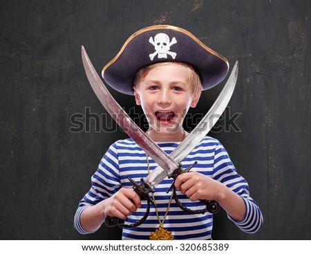 Little pirate boy with cutlass - stock photo