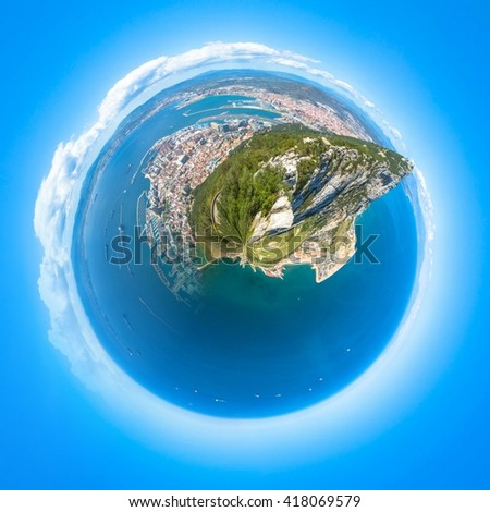 Little planet composition of an aerial view of the top of Gibraltar Rock, located in the Upper Rock Natural Reserve. United Kingdom, South West Europe. Globe concept, ecosystem, earth. - stock photo