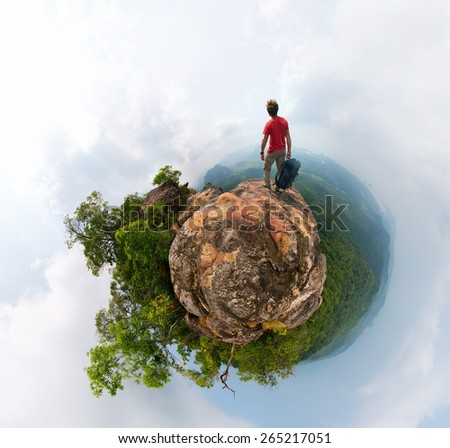 Little planet panorama of the hiker with backpack - stock photo