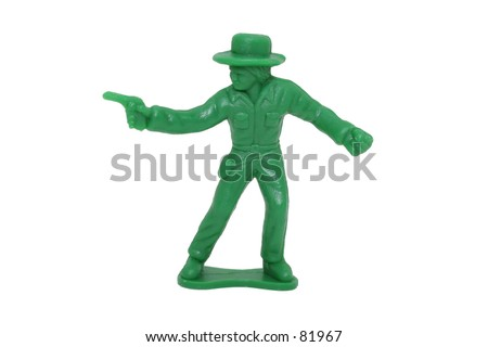 Little plastic green cowboy shot on white. Great detail.  Rough edge of form molding process left on.