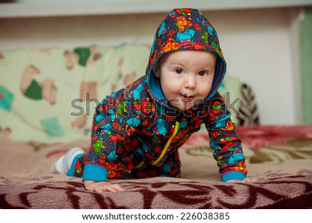 Little playful baby boy - stock photo