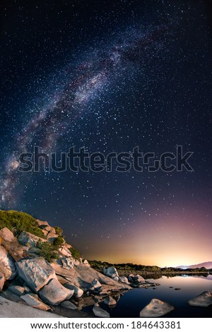 Little pond under the milky way - stock photo