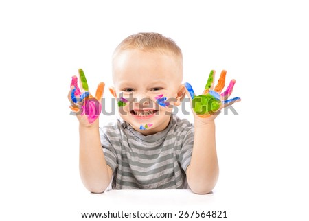 Little positive boy with painted hands in bright colors. - stock photo