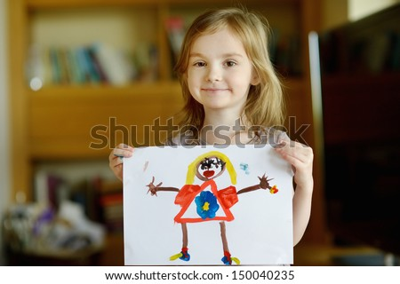 Little presch?oler girl displaying her picture proudly - stock photo