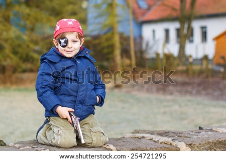 Little preschool boy of 4 years in pirate costume, outdoors - stock photo