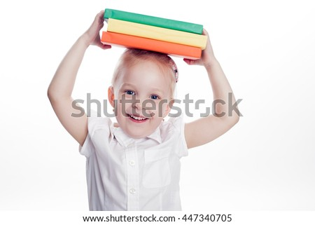 Little preschool girl hold books on the head, isolated on white background - stock photo
