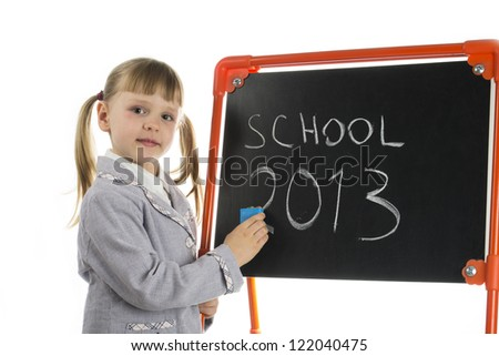 Little preschool pointing at dashboard - stock photo