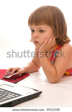 little preschooler girl discovering computer games, isolated on white