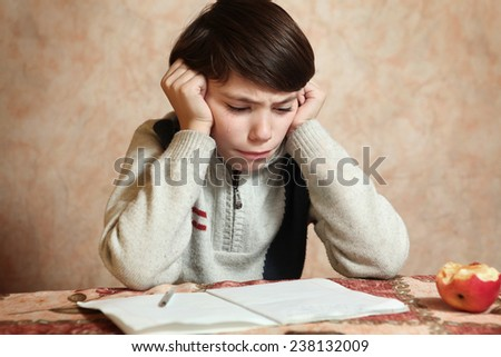 little preteen boy do his homework cry - stock photo