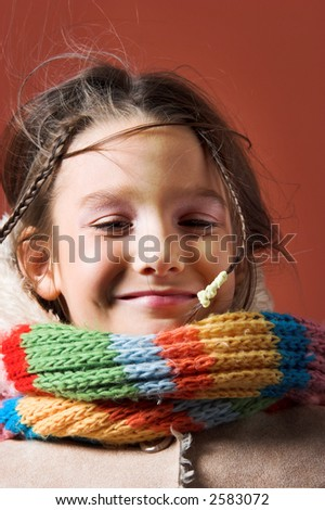 little pretty child with coat and scarf