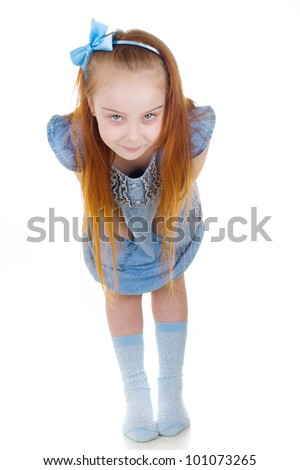 Little pretty ginger girl leaning forward and hiding her hands - stock photo