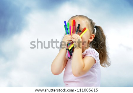 little pretty girl playing with markers - stock photo