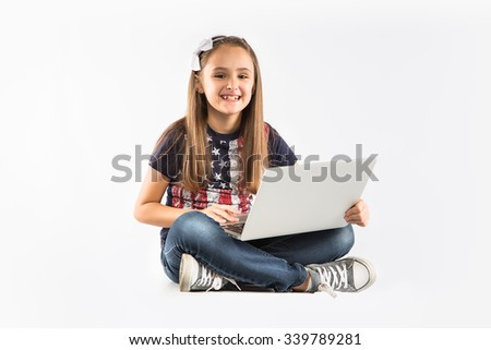 little pretty girl studying with computer. isolated on white background - stock photo