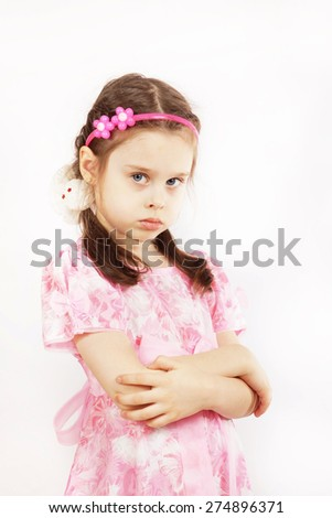 Little pretty girl wearing beautiful pink dress is angry