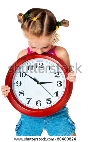 little pretty girl with red big clock - stock photo
