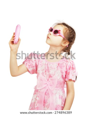 Little pretty girl with toy mobile - stock photo