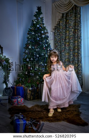 Little princess in christmas interior
