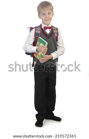 little pupil standing on white isolated background - stock photo