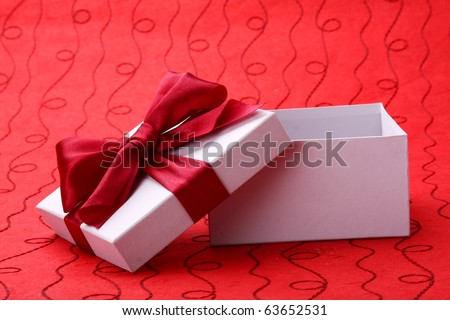 Little red gift on red background - stock photo