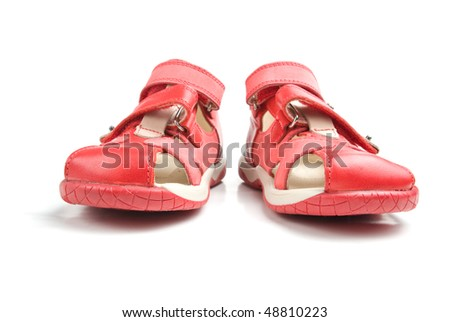 Little red kids shoes. Isolated on white background.