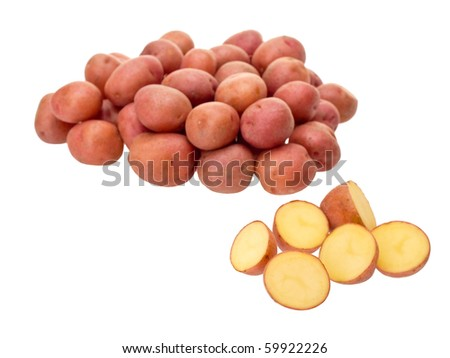 Little red potatoes sliced on pure white background - stock photo
