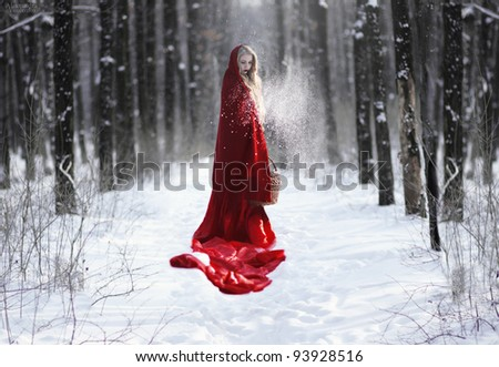 Little Red Riding Hood in the forest - stock photo