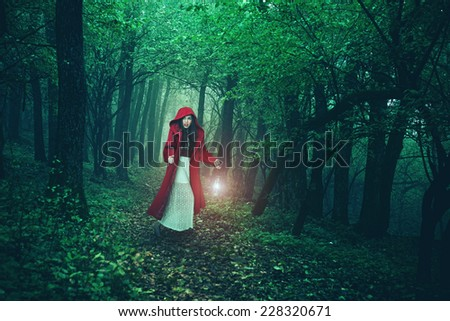 Little Red Riding Hood in the woods - stock photo