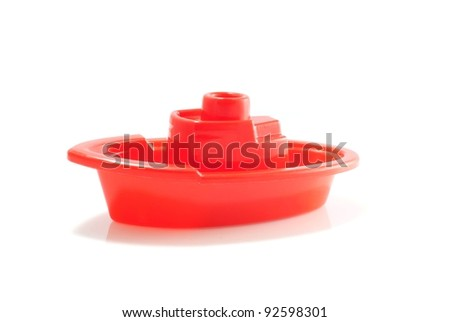 Little red toy boat - stock photo