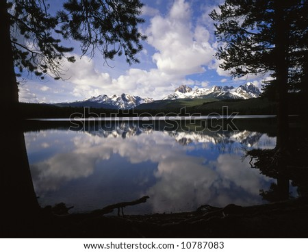 Little Redfish Lake and puffy clouds in the Sawtooth National Forest in Idaho. - stock photo