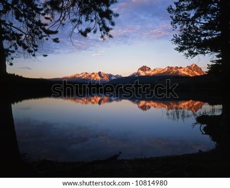 Little Redfish Lake & the Sawtooth Mountains, in Idaho, photographed at sunrise. - stock photo