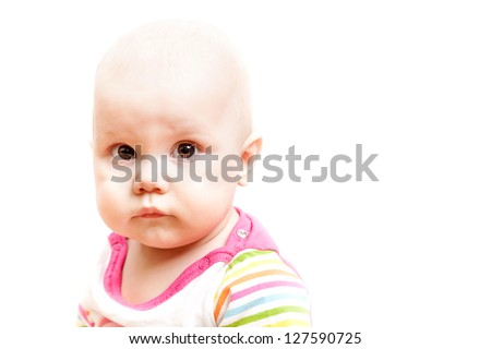 Little sad brown eyed baby, studio portrait isolated on white - stock photo