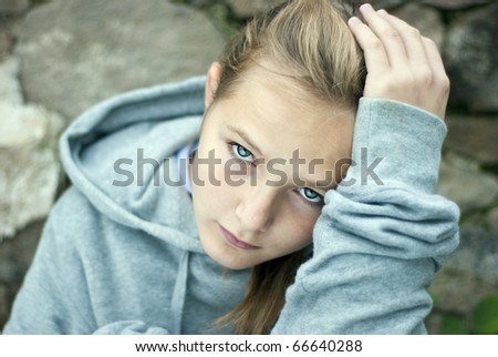 Little sad child is lonesome - stock photo