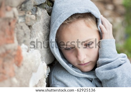 Little sad child with hood. - stock photo