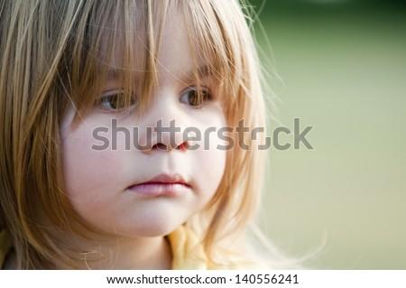 Little sad girl - stock photo