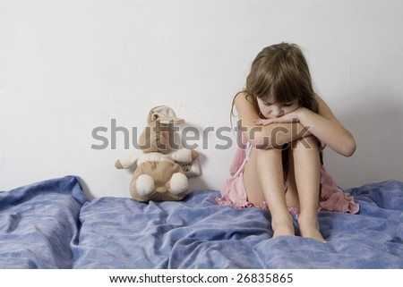 little sad young girl with hare - stock photo