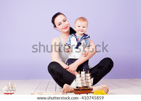 little sailor boy and his mom mother - stock photo