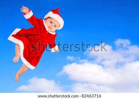 Little Santa Claus flying on the sky.