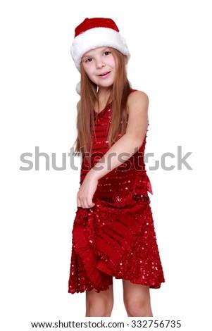 little santa girl dancing in studio on Christmas/Beautiful smiling caucasian girl on Holiday theme - stock photo