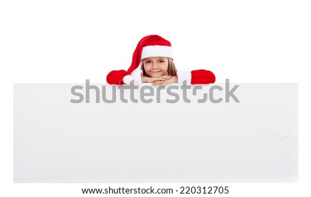 Little santa girl with large banner for copy - isolated - stock photo
