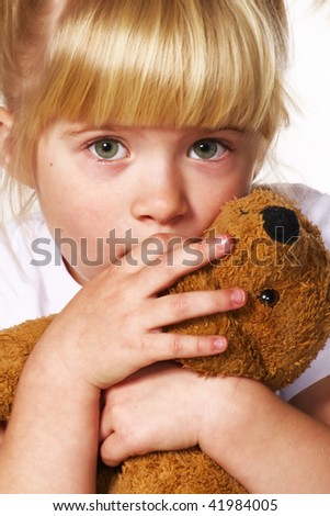 little scared girl with puppy toy - stock photo