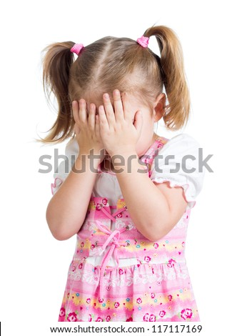 Little scared or crying or playing bo-peep girl hiding face - stock photo