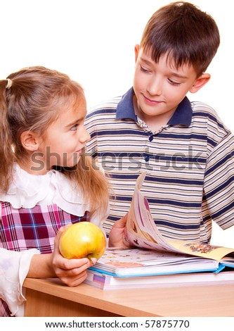 Little School Girl and Boy reading a book. Back to School. - stock photo