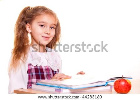 Little School Girl reading a book - stock photo