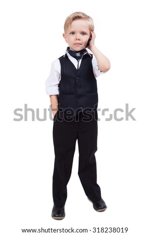 little schoolboy on a white background talking on the phone. Photo with artistic blur and depth of field - stock photo